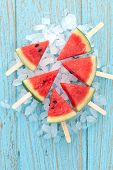 pic of popsicle  - watermelon popsicle yummy fresh summer fruit sweet dessert on vintage old wood teak blue - JPG