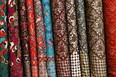picture of brocade  - Colored brocade fabric in a traditional indonesian bazaar - JPG