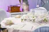 foto of wedding table decor  - Elegant table set in green and white for wedding or event party indoor - JPG