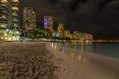 stock photo of waikiki  - Oahu Island Hawaii skyline at Waikiki after the sun has set - JPG