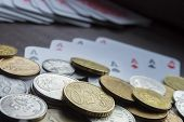 image of copper coins  - Various coins and poker cards closeup composition - JPG