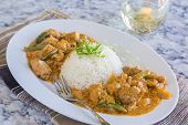 foto of curry chicken  - Chicken thighs and green bell peppers in panang curry sauce served with rice - JPG