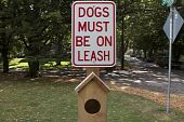 Dog on leash sign