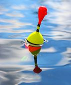 stock photo of fishing bobber  - Catching of fish - JPG