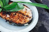 image of barbecue grill  - grilling salmon steak with milk cream in grid over barbecue - JPG