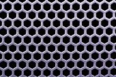 picture of metal grate  - Background from metallic grating with black holes - JPG