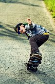 picture of 7-year-old  - Cool 7 year old boy with his skateboard on the street - JPG
