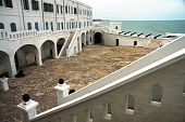 stock photo of turret arch  - Courtyard in Cape Coast castle in Ghana