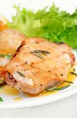foto of pork cutlet  - Grilled pork cutlet with orange sauce close up view shallow depth of field - JPG