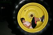 boy in tractor tire