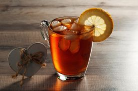 picture of black tea  - Black tea with ice and a slice of lemon in a glass mug - JPG