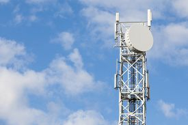 stock photo of antenna  - Telecommunications antenna tower for radio television and telephony with beautiful blue sky - JPG