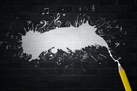 picture of musical scale  - Music notes and pencil on black background - JPG