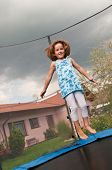 pic of bounce house  - Small cute child jumping on trampoline  - JPG