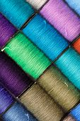 stock photo of lurex  - bobbins of lurex thread - JPG