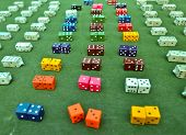 lots of colorful dice on the green baize