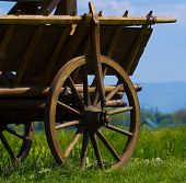 picture of mennonite  - old cart wheel transportation farm vehicle historical equipment - JPG