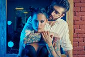 Brutal Man In Elegant Suit And Sexy Girl With Tattoo poster
