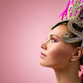 Beautiful Girl In Carnival  Headdress On Pink Background. poster
