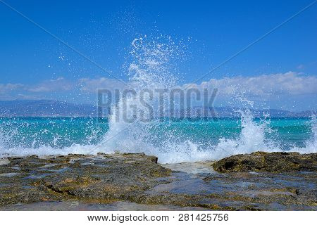 High Splashing Waves Breaking On