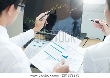 poster of Team Investment Entrepreneur Discussing And Analysis Forex Trading Charts And Graphs On Computer Scr