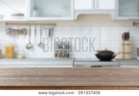 poster of Empty Brown Wooden Table In Modern Kitchen. Mockup For Design