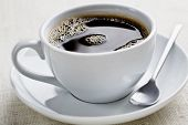 picture of cup coffee  - cup of freshly brewed black coffee focus is on the middle bubbles - JPG