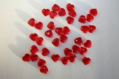 Valentines Day Red Hearts. Glass Hearts scattered on a white background. Valentines Day Images.  poster