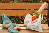 On The Wooden Surface Two Bags Of Food, One Of Cotton, The Other Cellophane.the Concept Of Choice Re poster