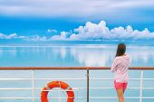 Cruise ship luxury travel woman on deck looking away in Tahiti. Serene still ocean water landscape.  poster
