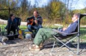 Blurred Background Out Of Focus. Tourist Camping With People And Guitar Theme Bokeh. Defocused Camp  poster