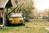 Abandoned Old Car Wreck In The Yard. Yellow Painted Old Russian Car. poster
