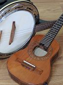 Close-up Of Two Brazilian String Musical Instruments: Cavaquinho And Samba Banjo On A Wooden Surface poster