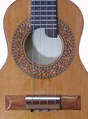 Close-up Of A Brazilian String Musical Instrument: Cavaquinho. It Is A Small Acoustic Guitar With Fo poster
