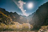 Tatra National Park, Poland. Calm Lake Czarny Staw Under Rysy And Summer Mountains Landscape. Sunshi poster