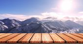 Empty Wooden Board Top Table In Front Of Blurred Snow Mountain View Background. Perspective Wood In  poster