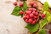 Raspberry In A Bowl, Berries And Leaves On A Shabby  Wood. Top View poster