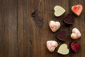 Heart-shaped Confection For Valentines Day On Dark Wooden Background Top View Copy Space poster