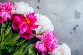Beautiful Fuchsia And White Peony Flower Bouquet On The Grey Concrete Background. Closeup, Flatlay S poster