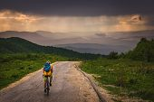 Cycling In Sunset. Lifestyle Concept. Man Cycling In Sunset In Mountain. Healthy Lifestyle. People L poster