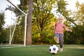 Little Boy Having Fun Playing A Soccer/football Game On Summer Day. Active Outdoors Game/sport For C poster