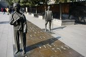 NANJING, CHINA - NOVEMBER 24: Visitors view the statues of the massacre survivors and their recent f