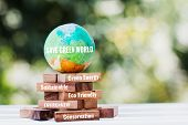 Save World Or Earth Day Concept. Model Globe Clay With Radar On Wooden Block Tower For Letter E.g Ea poster
