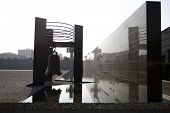 NANJING, CHINA - NOVEMBER 24: An ancient bell adorns the exterior wall of the Massacre Memorial Hall