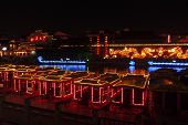 NANJING, CHINA - NOVEMBER 23: Tourists take the night river boat cruise on the Qinhuai River on Nove
