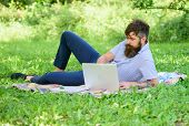 Man Bearded With Laptop Relaxing Meadow Nature Background. Writer Looking For Inspiration Nature Env poster