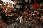 Couple Having Fun. Couple In Love In Turkey. Man And Woman In The Eastern Country. Gift Shop. A Coup poster