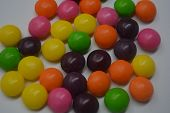 Bright Multicolored And Colored Balls, Sweet And Tasty Sweets, Candies Scattered On A White Backgrou poster