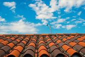 Roof With Terracotta Tile In Miami, Usa. Tile Roofing On Cloudy Blue Sky. Architecture And Design. R poster