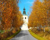 Road to Bila Hurka (white hill) with baroque church of St. Stephen and rare medieval village from 14